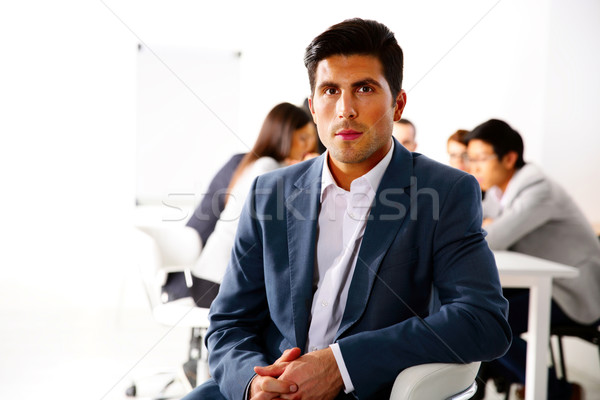 Businessman sitting on the office chair in front of business meeting Stock photo © deandrobot