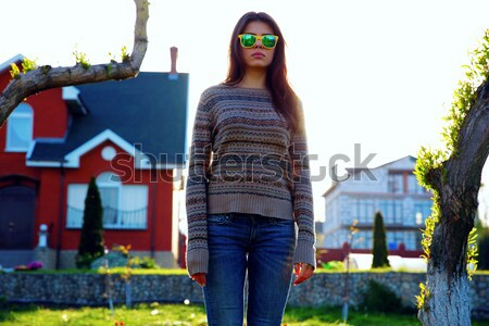 Full-length portrait of a young woman standing in garden Stock photo © deandrobot