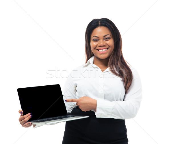 Empresária indicação laptop tela alegre africano Foto stock © deandrobot