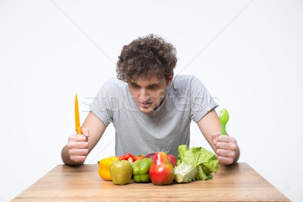éhes férfi ül asztal zöldségek haj Stock fotó © deandrobot