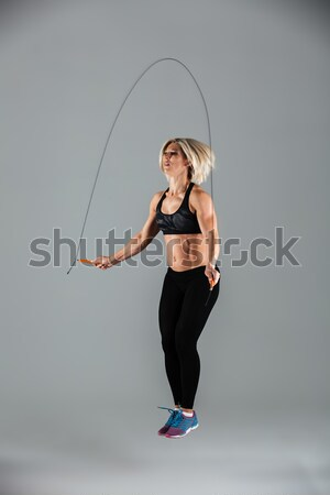 Sports woman jumping with skipping rope Stock photo © deandrobot