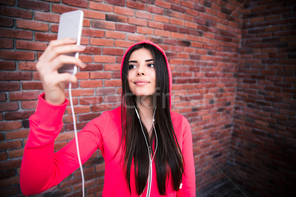 Happy young sportive woman making selfie photo Stock photo © deandrobot