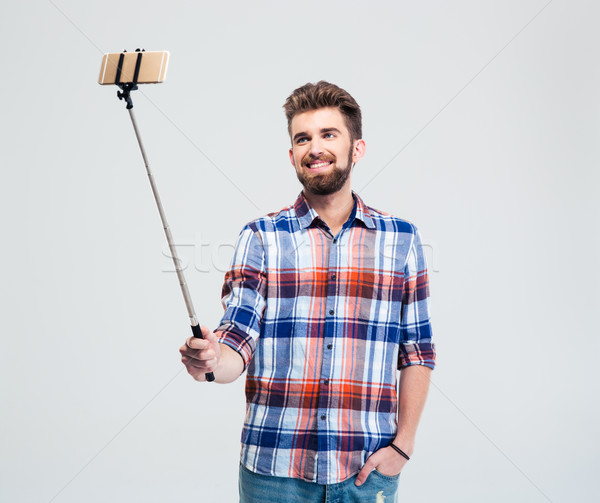 Happy casual man making selfie photo Stock photo © deandrobot