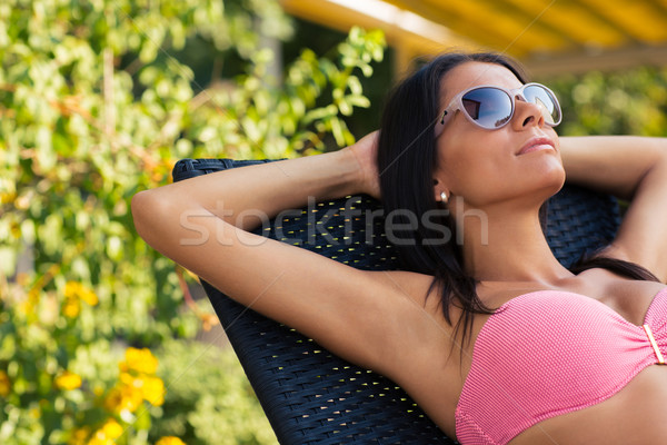 Charming woman sunbathing on the deckchair  Stock photo © deandrobot