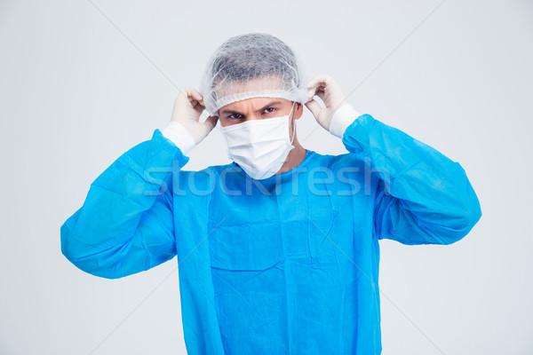 Portrait Homme chirurgien permanent isolé blanche Photo stock © deandrobot