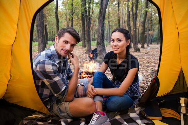 çift oturma şenlik ateşi orman mutlu güzel Stok fotoğraf © deandrobot