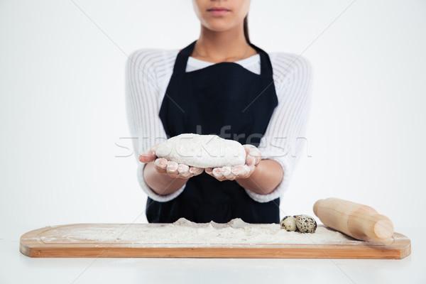 Female hands preparing dough for pastry  Stock photo © deandrobot