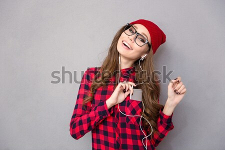 Happy woman with scarf and hat holding jewelry gift box Stock photo © deandrobot