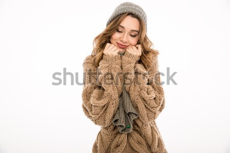 Portrait of young beautiful girl in knitted sweater Stock photo © deandrobot