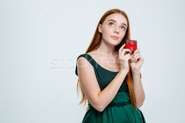 Woman holding jewelry box and dreaming Stock photo © deandrobot