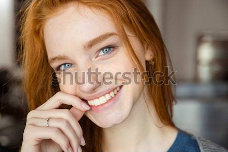 Redhead woman in bathrobe looking at camera Stock photo © deandrobot