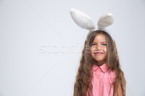 Portrait of a smiling little girl with bunny ears  Stock photo © deandrobot