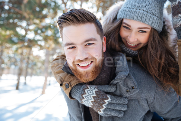 Smling couple walking in winter park Stock photo © deandrobot