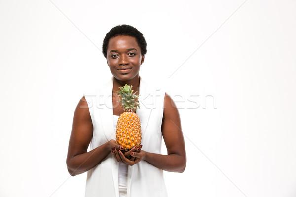 Mosolyog csinos afroamerikai fiatal nő áll tart Stock fotó © deandrobot