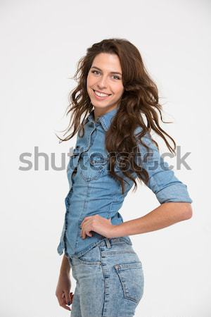 Portrait of happy beautiful young woman with fluttering wavy hair  Stock photo © deandrobot