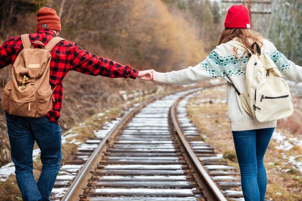 Belle mains tenant marche chemin de fer ensemble Photo stock © deandrobot