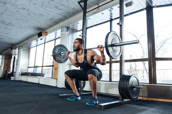 Muscular Man Doing Heavy Deadlift Exercise Stock photo © deandrobot