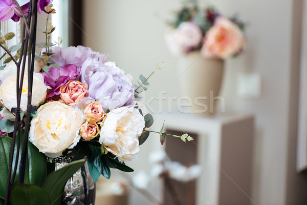 Bouquets of beautiful flowers standing in vases Stock photo © deandrobot