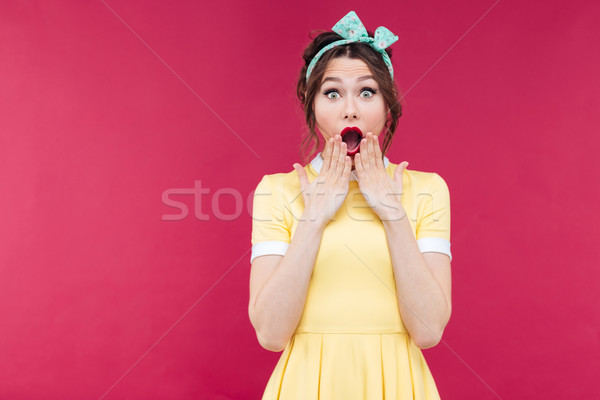 Wondered pinup girl in yellow dress with mouth opened Stock photo © deandrobot
