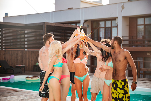 Group of best friends having party by pool outdoors Stock photo © deandrobot