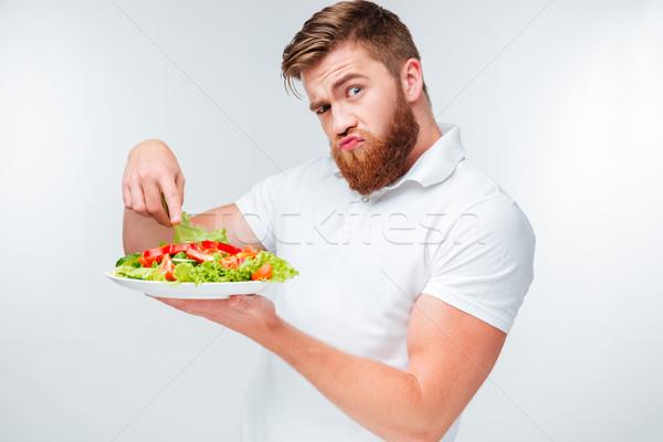 Confundirse barbado hombre placa ensalada Foto stock © deandrobot