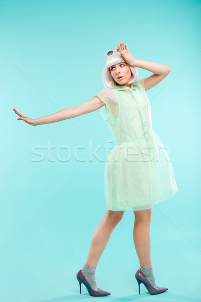 Full length of pretty young woman refusing and walking away Stock photo © deandrobot