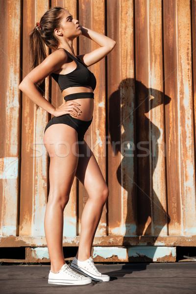 Genç kadın siyah mayo ayakta gözleri kapalı Stok fotoğraf © deandrobot