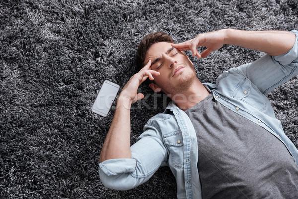 Człowiek piętrze głowy portret telefon Zdjęcia stock © deandrobot
