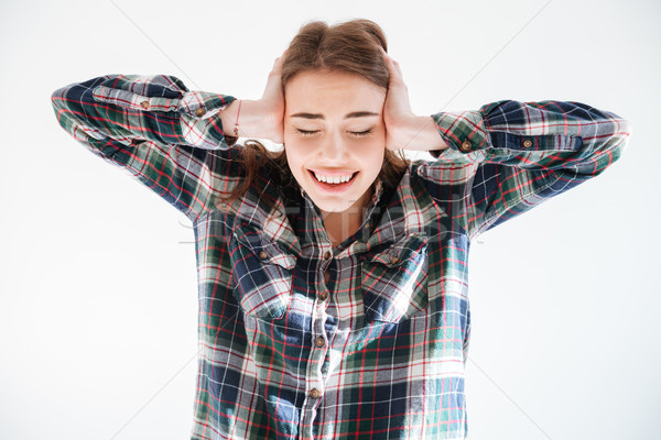 Stressed tensed woman in plaid shirt covered ears by hands Stock photo © deandrobot