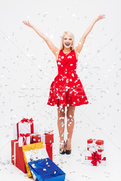 Christmas girl with tinsel Stock photo © deandrobot