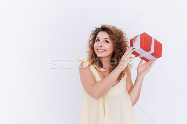 Happy woman in singlet with gift Stock photo © deandrobot