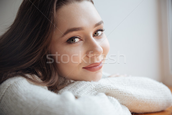 Close up model in sweater near the window Stock photo © deandrobot