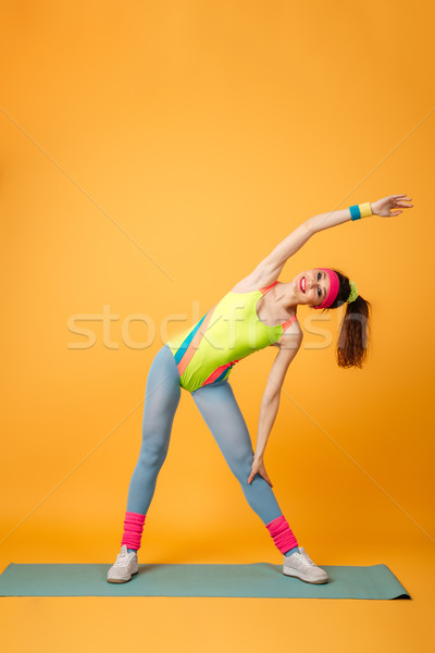 Stock photo: Happy young sports lady make sports exercises