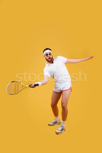 Függőleges kép koncentrált játszik tenisz napszemüveg Stock fotó © deandrobot
