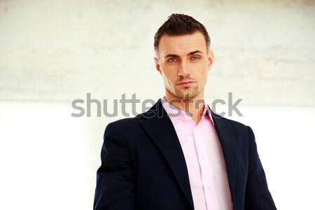 Business man standing sideways Stock photo © deandrobot