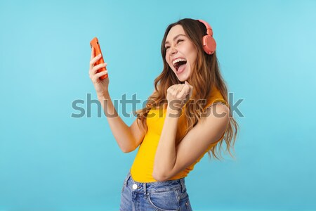 Smiling Woman in beachwear making selfie Stock photo © deandrobot