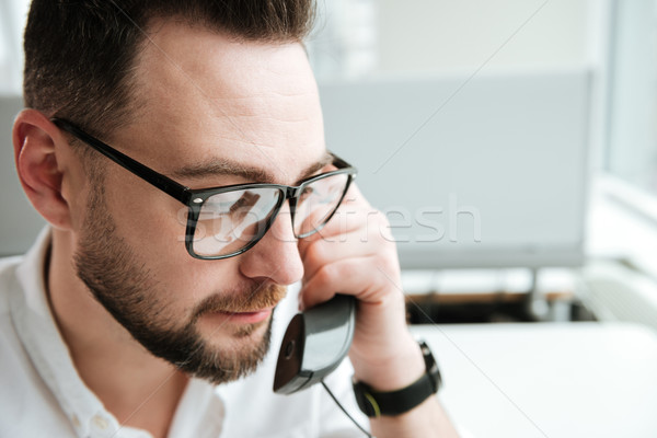Close up portrait of Man talking on phone Stock photo © deandrobot