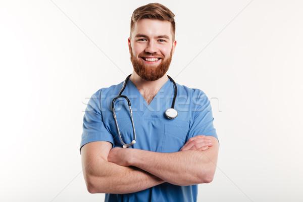 Portre gülen erkek doktor ayakta silah katlanmış Stok fotoğraf © deandrobot