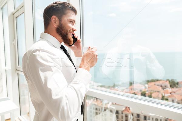 側面図 笑みを浮かべて ビジネスマン 飲料 コーヒー 話し ストックフォト © deandrobot