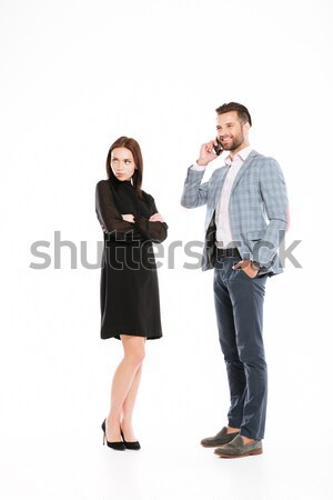 Sad woman looking aside while man talking by phone Stock photo © deandrobot