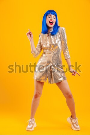 Full length portrait of an excited crazy blonde woman Stock photo © deandrobot