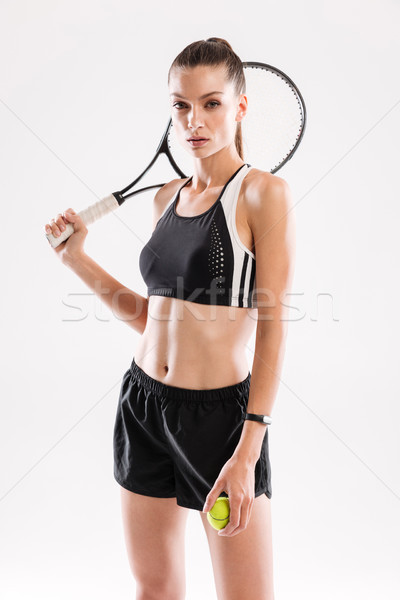 Portrait of a cocentrated slim woman in sportswear Stock photo © deandrobot