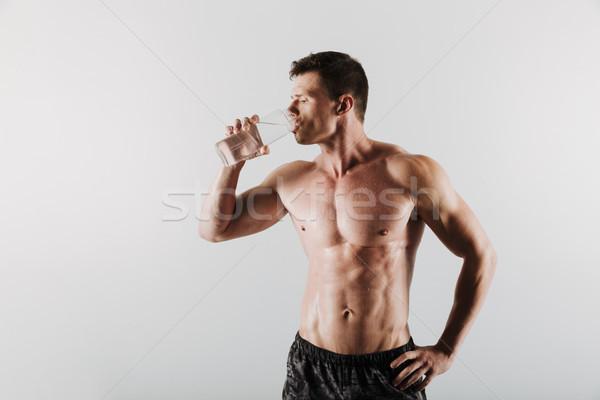 Starken ernst jungen Sportler Trinkwasser Bild Stock foto © deandrobot