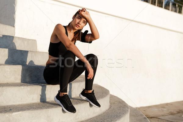 Stockfoto: Verbazingwekkend · jonge · sport · vrouw · luisteren · muziek