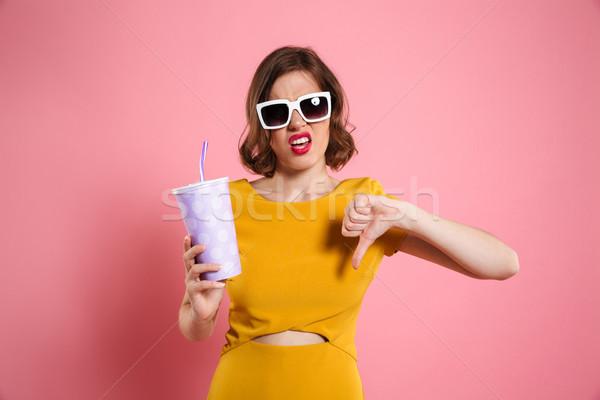 Portret teleurgesteld meisje zonnebril beker Stockfoto © deandrobot