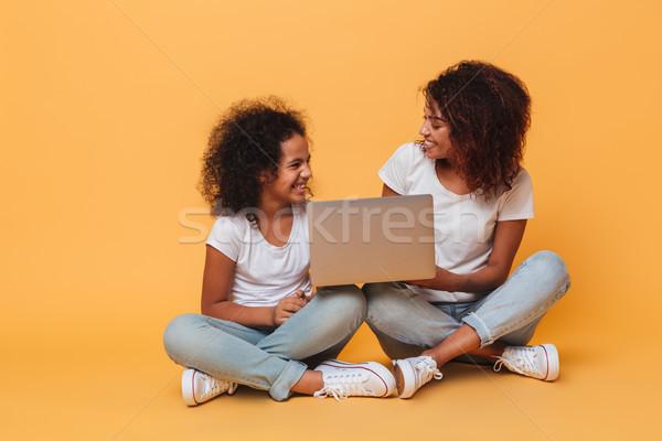 два радостный афро американский используя ноутбук Сток-фото © deandrobot