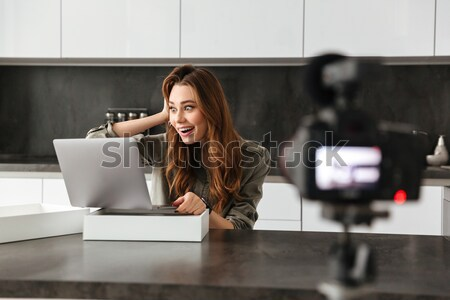 Cheerful young girl recording video blog episode Stock photo © deandrobot
