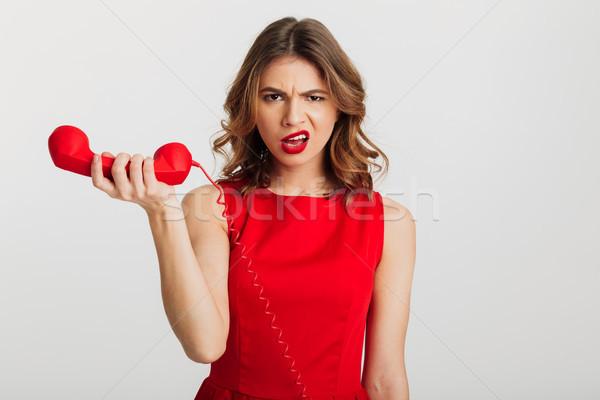 肖像 若い女性 赤いドレス 電話 孤立した ストックフォト © deandrobot