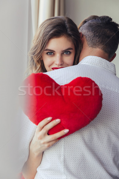 Portrait of a pretty young woman holding her boyfriend Stock photo © deandrobot