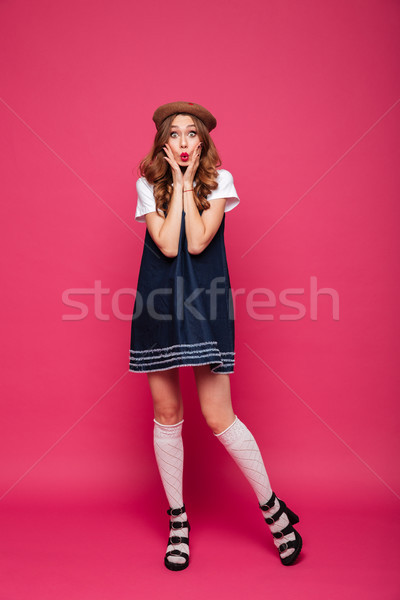 Shocked woman looking camera with opened mouth isolated Stock photo © deandrobot